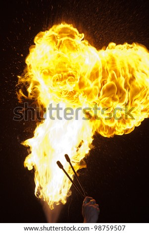 Fire explosion from an fire-breather in the Night - stock photo