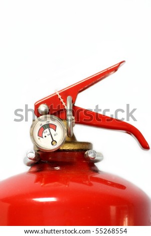 Fire extinguisher in workplace. - stock photo
