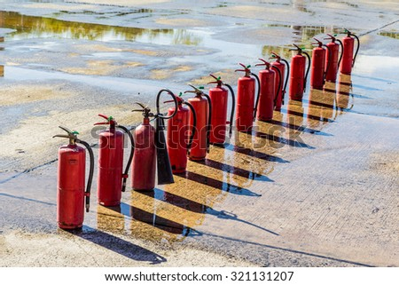 Fire extinguishers ,Firefighter fighting fire during training - stock photo