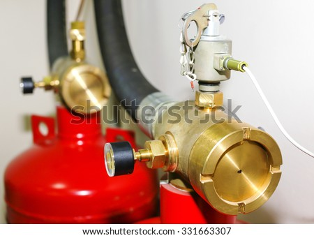 fire extinguishing system in the office. a closeup of the fire extinguishing system in an office building - stock photo