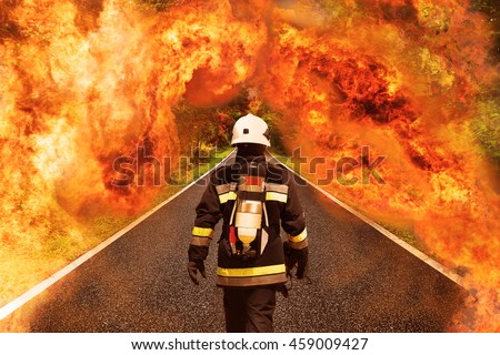 Fire fighter go to the forest for fighting with fire, Team work and operation with fire case and the mission should be successful, Fire fighter with suit and equipment for operation in fire case. - stock photo