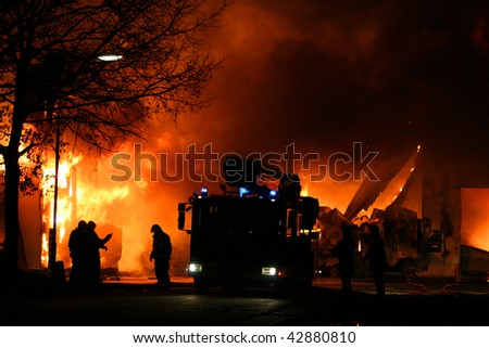 Fire fighters at work - stock photo