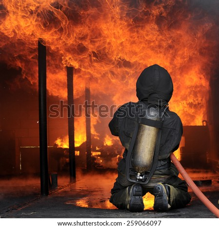 Fire fighters during training - stock photo
