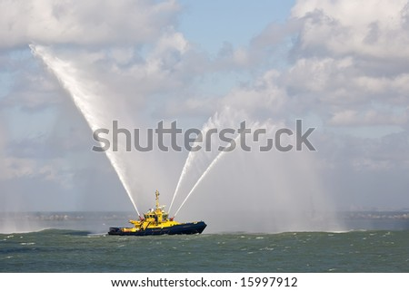 Fire Fighting Boat sprays water - stock photo