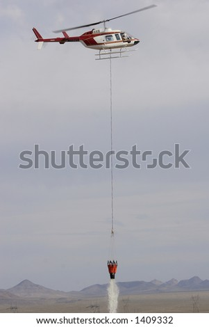 Fire fighting helicopter in action - stock photo