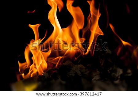 Fire flames burn confidential documents evidence - stock photo
