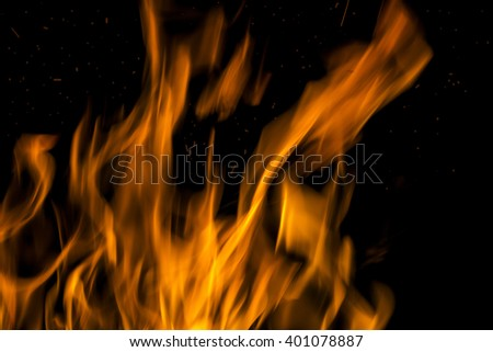 Fire flames on a black background. Blaze fire flame texture background. Close up of fire flames isolated on black background. Burn. Abstract fire flames background. Texture - stock photo