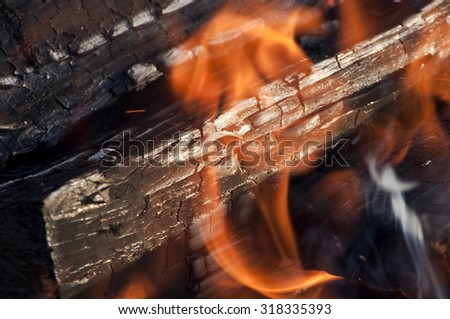 Fire from burning firewood with ashes and flames - stock photo