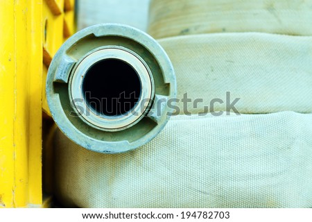Fire hose detail. Retro vintage filter. - stock photo