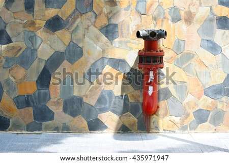 Fire hose nozzle on brick wall background, Fire valve, installation of fire safety,Security fire system in industry or the process - stock photo