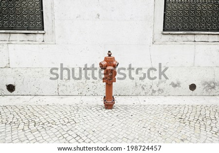 Fire hydrant in a city, detail of an item to put out fires, real protection and safety - stock photo
