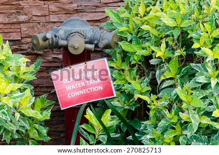 Fire Hydrant in the garden - stock photo
