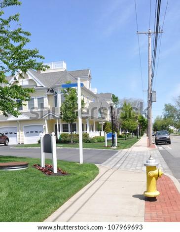 Fire Hydrant on Suburban Neighborhood Street sunny blue sky day - stock photo