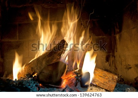 Fire in a fireplace - stock photo