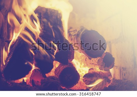 Fire in a fireplace / selective focus - stock photo