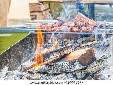 Fire in barbecue. Burning log of wood. - stock photo