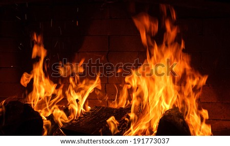 Fire in Fireplace. burning firewood - stock photo