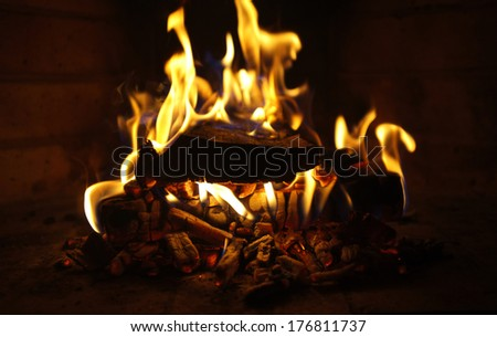 Fire in fireplace, close-up - stock photo