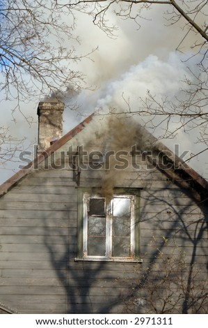 Fire in house - stock photo