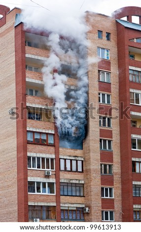 Fire in one of the apartments of a large tenement-house - stock photo