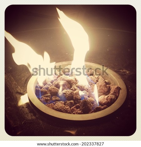 Fire in outdoors fire pit - Camp fire  - instagram effect - stock photo