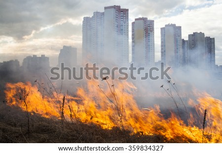 Fire in the field near the city (Kyiv, Ukraine). - stock photo