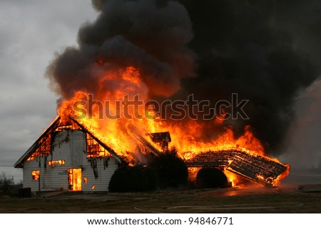 Fire is the most destructive force of nature, as in this image of a burning building, and yet it is also one of the most important forces for the good of mankind when under man's control. - stock photo