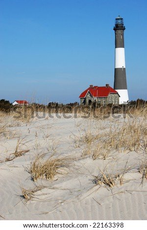 Fire Island Lighthouse as seen looking up from the beach. Located at Fire Island National Seashore, Long Island, New York - stock photo