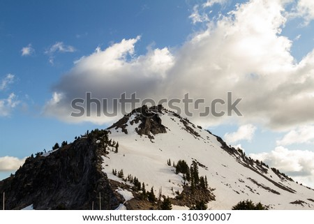 fire lookout tower on top of the mountain in Crater Lake National Park - stock photo