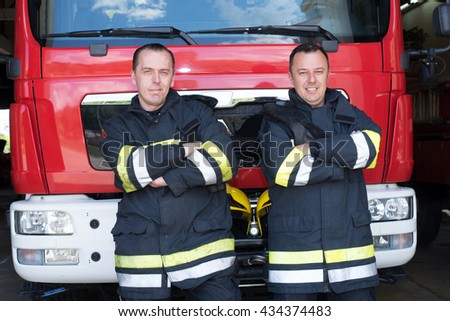 Fire mans on duty,under exposed photo - stock photo