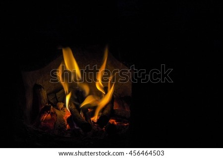 Fire on a stove in the night. Background. - stock photo