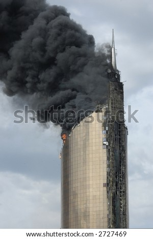 fire on high-altitude building - stock photo