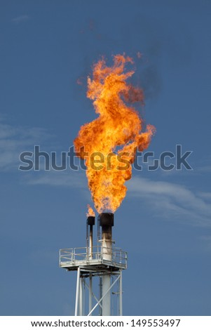 fire on rig in the gulf of thailand - stock photo