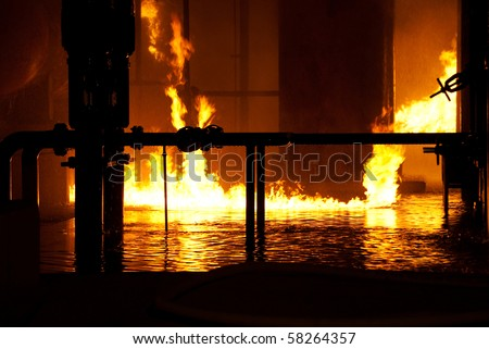 fire on water in industrial fire - stock photo