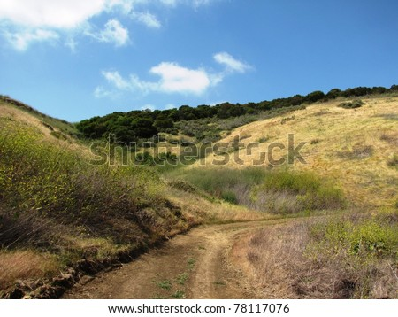 Fire road and hills, Quail Trail, Irvine, CA - stock photo