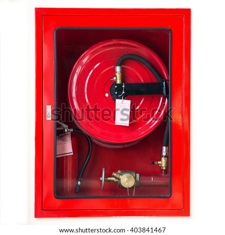 Fire safety equipment in the red box on wall cement - stock photo