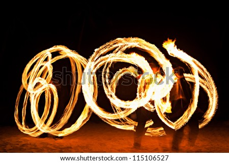 Fire show at the beach, Goa - stock photo
