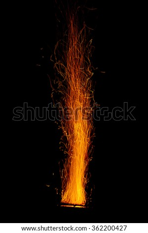 Fire sparks on black background. - stock photo