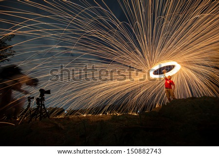 Fire spinning from steel wool - stock photo