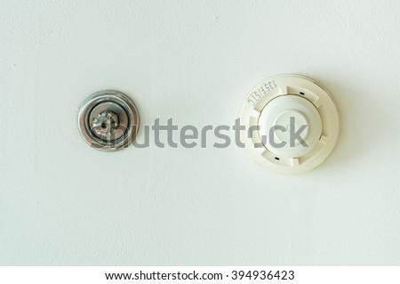 Fire sprinkler and smoke detection unit on white background - stock photo