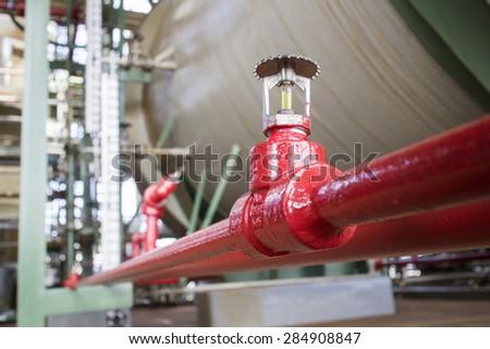 Fire sprinkler in petrochemical plant. - stock photo