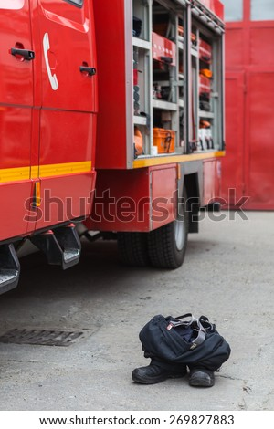 Fire truck and clothes - stock photo