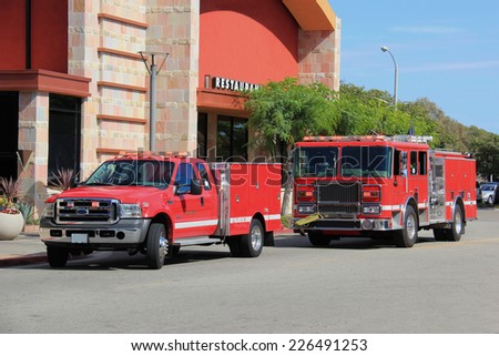 Fire Truck and Paramedic Truck rush to help people at the scene. - stock photo
