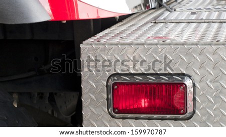 Fire truck detail that parked on fron t of the fire station. - stock photo
