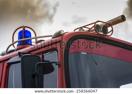 Fire truck fighting with fire - stock photo