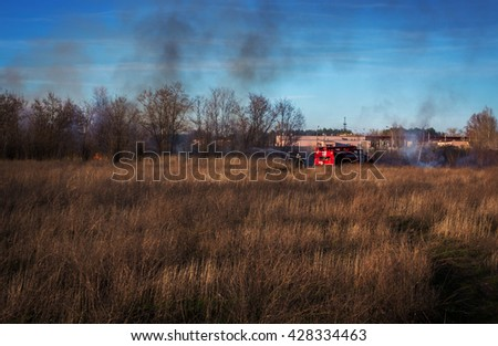 fire truck to put out a forest fire. firefighters to extinguish the fire. wildfire - stock photo