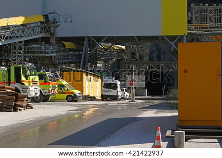 Fire trucks and ambulance and other safety equipment always ready at the entrance of a mining site - stock photo