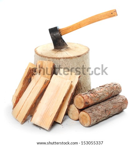 Fire wood and old axe. Renewable resource of a energy. - stock photo