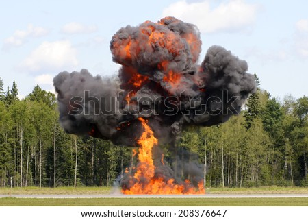 Fireball forming out of an explosion in a outdoor field  - stock photo