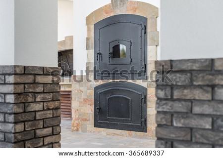 Firebox door of a retro wood burning stove - stock photo
